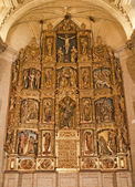 TOLEDO - MARCH 8: Polychrome main altar of San Roman church has a steeple built in the mudejar architectural style in the 13th cent. on March 8, 2013 in Toledo, Spain. — Stock Photo