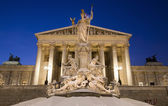 Vienna - Pallas Athena fountain and parliament in winter evening — Stock Photo