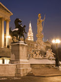Vienna - Pallas Athena fountain and parliament in winter evening and Town hall tower in background — Stock Photo
