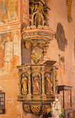 STITNIK, SLOVAKIA - DECEMBER 29, 2013: Baroque pulpit from year 1693 with the statue of four evangelists and Jesus in gothic evangelical church in Stitnik. — Stock Photo
