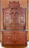 JASOV, SLOVAKIA - JANUARY 2, 2013: Carved sideboard from 19. cent. in hall from Premonstratesian cloister in Jasov. — Stock Photo