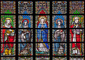 BRUSSELS - JUNE 22: Virgin Mary and saints from windowpane in gothic church Notre Dame du Sablon on June 22, 2012 in Brussels. — Foto de Stock