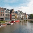 GENT - JUNE 23: Kraanlei street with the canal and typical houses on June 23, 2012 in Gent, Belgium. — Stock Photo