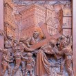 Stock Photo: ANTWERP, BELGIUM 5: Simon of Cyrene helps Jesus to carry his cross.. Carved relief in St. Pauls church (Paulskerk) on September 5, 2013 in Antwerp, Belgium