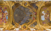 "VIENNA - JULY 3: Frescos from ceiling of nave in baroque Jesuits church by Andrea Pozzo in 1703, the remarkable ""trompe l'oeil dome"" on July 3, 2013 Vienna. — Stock Photo"