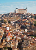 Toledo - Alcazar and town in morning light — Stok fotoğraf