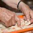 Stock Photo: Grandmother hands at baking