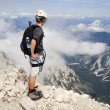 Mountaineer on summit of Jalovec peak in Julialps - Slovenia — Stock Photo #39020035