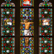 BRATISLAVA, SLOVAKI- JANUARY 14, 2014: Crucifixion on windowpane from 19. from manufactures of KarolGeyling and EduardKratzmann in st. Martin cathedral. — Stock Photo #39731365