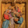 BRATISLAVA, SLOVAKIA - JANUARY 14, 2014: Presentation of Jesus in the Temple scene. Carved relief from 19. cent. by Ferdinand Prinoth from St. Ulrich on gothic side altar in st. Martin cathedral. — Stock Photo