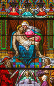 BRATISLAVA, SLOVAKIA - JANUARY 14, 2014: Pieta on windowpane from 19. from manufactures of Karola Geyling and Eduarda Kratzmann in st. Martin cathedral. — Stock Photo