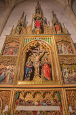 BRATISLAVA, SLOVAKIA - JANUARY 14, 2014: Side altar of curcufixion. Carved from 19. cent. by Ferdinand Prinoth from St. Ulrich on gothic side altar in st. Martin cathedral. — Stock Photo