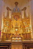 MADRID - MARCH 9: Main carved neo-gothic altar of church Santa cruz on March 9, 2013 in Spain. — Stock Photo