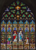 MECHELEN, BELGIUM - SEPTEMBER 6: Jesus ans his mother. Windowpane of St. Rumbold's cathedral on September 6, 2013 in Mechelen, Belgium. — Stock Photo