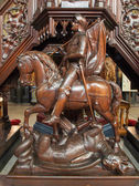 ANTWERP, BELGIUM - SEPTEMBER 5: St. George sculpture on the carved pulptit of Joriskerk or st. George church from 19. cent. on September 5, 2013 in Antwerp, Belgium — Stock Photo