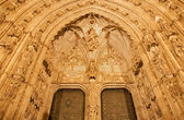 TOLEDO - MARCH 8: South gothic portal of Cathedral Primada Santa Maria de Toledo at night on March 8, 2013 in Toledo, Spain. — Stock Photo