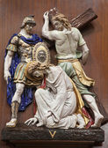 VERONA - JANUARY 28: Jesus fall under cross. One part of ceramic coss way from st. Nicholas church (Chiesa di San Nicolo) on January 28, 2013 in Verona, Italy. — Stock Photo
