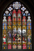 BRUSSELS - JUNE 22:Scene of martyrdom from Windowpane in st. Michael s gothic cathedral on June 22, 2012 in Brussels. — Stock Photo