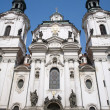 Facade of st. nicholas church in prague — Stock Photo