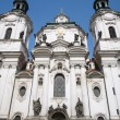 Facade of st. nicholas church in prague — Stock Photo #39747107