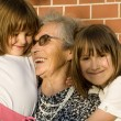 Stock Photo: Grandmother and grandchildren