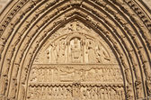 Paris - detail from side portal of Notre Dame cathedral in the sunset light — Stock Photo