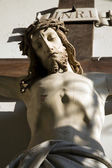 Jusus on the cross from entry of Vienna church — Stock Photo