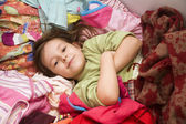 Little girl in the clothes — Stock Photo