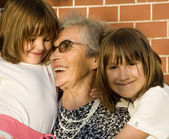 Grandmother and grandchildren — Stock Photo