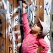 Stock Photo: Curiosity of little girl on street - door