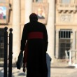 Rome - silhouetts of monsignor for st. Peters basilica — Stock Photo