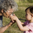Grandmother and grandchild - keeping — Stok fotoğraf