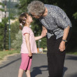 Stock Photo: Grandmother and grandchild by the walk