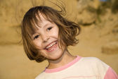 Atractive smile of little girl — Stock Photo