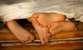 Feet of childre in the bed — Stock Photo