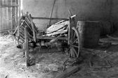 Old cart in old barn — Stock Photo