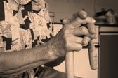 Hands of old woman with stick — Stock Photo