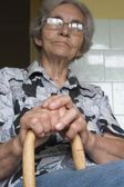 Grandmother with staff — Stock Photo