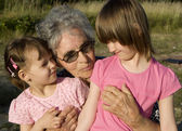 Grandmother with his grandchilds — Stock Photo