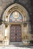 Portal of gothic cathedral on vysehrad in prague — Stockfoto