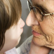 Faces of grandmother and grandchild — Stock Photo