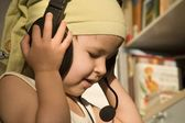 Baby withe the earphone — Stock Photo