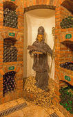 BRATISLAVA, SLOVAKIA - JANUARY 23, 2014: Saint Urban carved statue from interior of wine cellar of great Slovak producer. — 图库照片