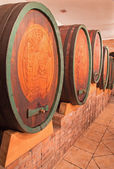 BRATISLAVA, SLOVAKIA - JANUARY 30, 2014: Carved casks in wine cellar of great Slovak producer. — Stock Photo