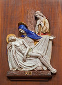 VERONA - JANUARY 28: Pieta. One part of ceramic coss way from st. Nicholas church (Chiesa di San Nicolo) on January 28, 2013 in Verona, Italy. — Stock Photo