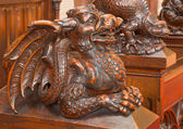 BRATISLAVA, SLOVAKIA - FEBRUARY 11, 2014: Dragon carved sculpture from bench in presbytery in st. Matins cathedral from years 1863 - 1878 from manufactures of Anton Furst a Johann Hutterer. — Stock Photo