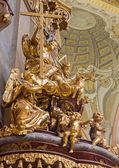 VIENNA - JULY 3: Sculpture of Holy Trinity on the pulpit of baroque st. Peter church or Peterskirche on July 3, 2013 Vienna. — Stock Photo