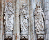 BRUSSELS - JUNE 21: Detail from side portal of Notre Dame du Sablon gothic church built in the 15th and 16th centuries. Apostle and holy Mary statues on June 21, 2012 in Brussels. — Stock Photo