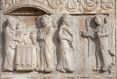 VERONA - JANUARY 27: Presentation of Jesus in the Temple from facade of romanesque Basilica San Zeno. Reliefs is work of the sculptor Nicholaus and his workshop on January 27, 2013 in Verona, Italy. — Stock Photo