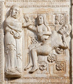 VERONA - JANUARY 27: Relief of creation of woman facade of romanesque Basilica San Zeno. Reliefs is work of the sculptor Nicholaus and his workshop on January 27, 2013 in Verona, Italy. — Stock Photo